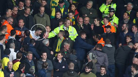 5. Wells (circled) appears to lose his balance as he is led away by stewards. Picture by Paul Cheste