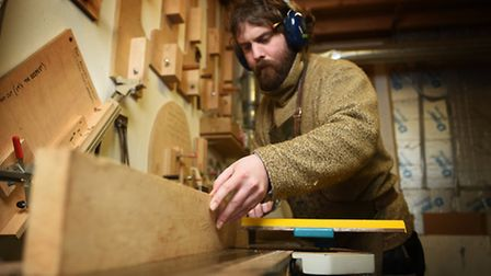 Making a banjo at Shackleton Instruments, Hellesdon Barns, Norwich. Geoff Ransome planing the wood.