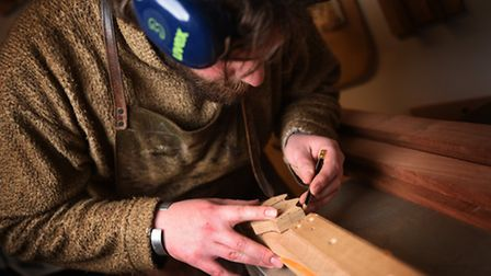Making a banjo at Shackleton Instruments, Hellesdon Barns, Norwich. Geoff Ransome marking the patter