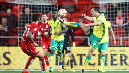 Jonny Howson clears as Norwich City hang on for a point at Bristol City earlier this month. Picture: