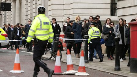 Police close to the Palace of Westminster, London, after policeman has been stabbed and his apparent