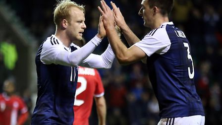 Scotland's Steven Naismith celebrates scoring his side's equaliser against Canada with Lee Wallace (
