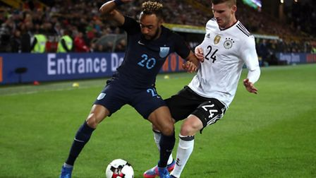 Former Norwich City winger Nathan Redmond, left, battles with and Germany's Timo Werner during his i