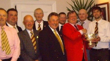 The winning team in the Clymer Bowl competition receiving the trophy from club captain Alistair Low