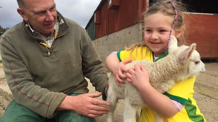 Mia Digby-Randell, 6, from Reepham (right) won a competition to name a lamb at the Easton and Otley