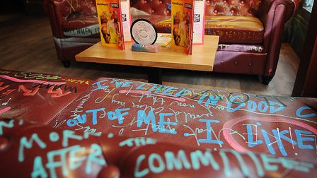 Graffiti covers sofas in the lounge. Picture: Chris Bishop