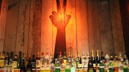 A peace sign behind the bar. Picture: Chris Bishop