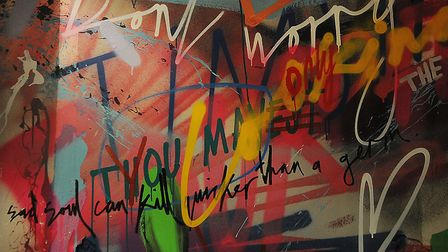 Splashes of colour and graffiti on a wall. Picture: Chris Bishop