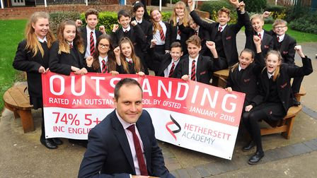 Principal of Hethersett Academy, Gareth Stevens, with some students after the school's outstanding O
