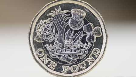 """The new new 12-sided �1 coin, which will start to enter circulation on Tuesday, as the old """"round po"""