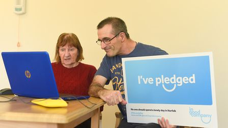 Steve Moss has been helping residents at a care home in Watton to use Skype. Also pictured is Dot Ha