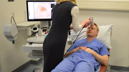 The confocal microscope being tested on a staff member by Dr Jennifer Garioch. Picture: N&N