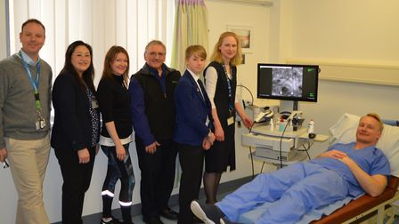 Fundraisers with the dermatology team and the new microscope. L to R: Plastic surgeon Marc Moncrieff