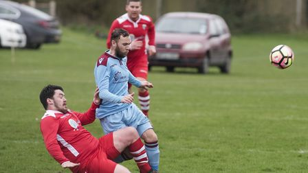 Anglian Combination football action between Spixworth (blue) and Stalham (red)PHOTO: Nick Butcher