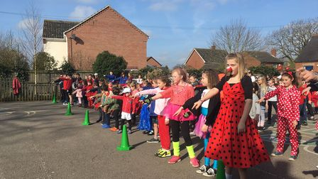 Pupils at staff of Freethorpe Community Primary and Nursery School take part in a flash mob for Comi