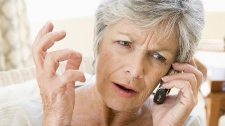 A generic picture of a woman annoyed with a cold caller. Picture: PA