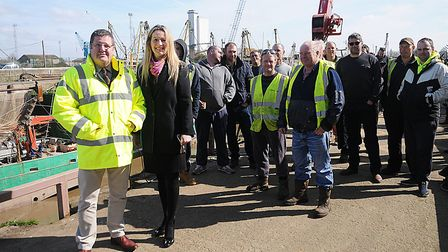 Mike Hookem (far left) and June Mummery with fishermen at King's Lynn. Picture: Chris Bishop