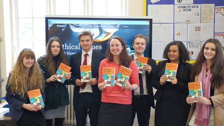 Daniella Dunsmore, head of religious studies at Thetford Grammar School, with copies of her revision