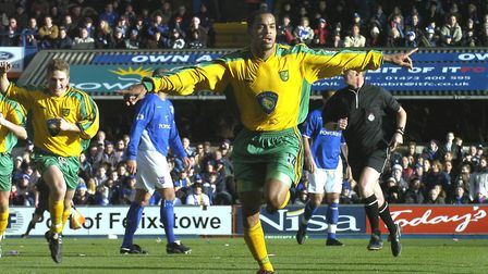 Leon McKenzie celebrates the first of his debut goals during Norwich City's 2-1 win at Ipswich in D