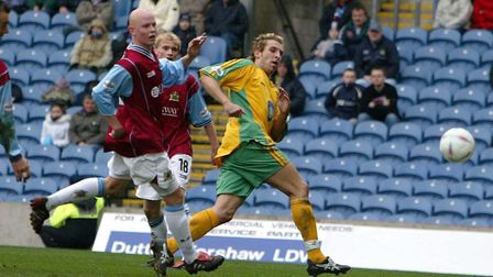 Darren Huckerby scores Norwich City's fifth goal in a 5-3 win at Burnley late in the 2003/04 campaig