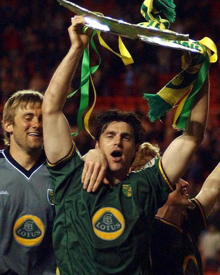 Norwich`s Marc Edworthy celebrates infront of the travelling fans with a model of the Division One t
