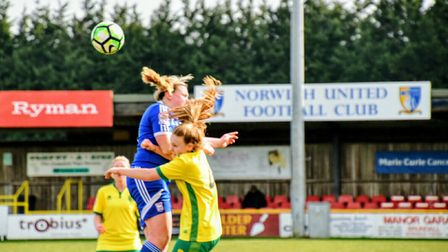Norwich City Ladies' Millie Davis goes up for a header against Ipswich on Sunday. Picture: Brian Coo