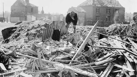 Aftermath of the air raid in Norwich, 1942. An Anderson shelter standing intact amid a scene of debr
