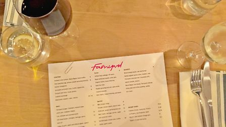Menu and wine at Farmyard Restaurant. Photo by Emily Revell