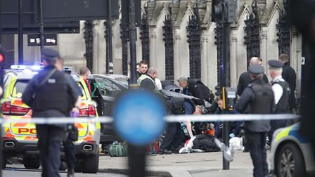 Emergency services close to the Palace of Westminster, London, after sounds similar to gunfire have