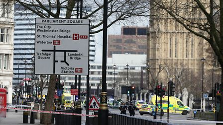 Emergency personnel close to the Palace of Westminster, London, after policeman has been stabbed and