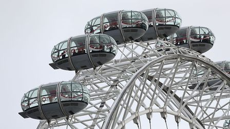 People remain in pods on the London Eye after it was stopped, after a policeman was stabbed and his