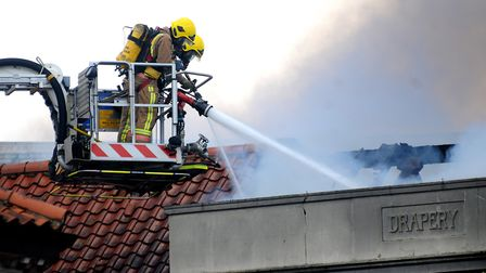 Fire fighters tackling the blaze in May, 2014. PHOTO: ANTONY KELLY