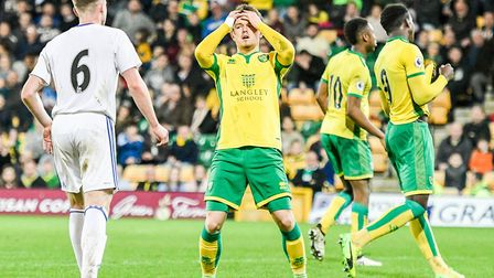Glenn Middleton of Norwich City U23 comes close to scoring and shows his frustration during the Prem