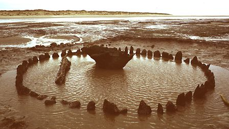 Seahenge on the North Norfolk coast. The Norfolk Archaeological Unit, which became NAU Archaeology,