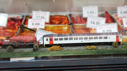 The 'Sausage Express' miniature train in the window of M and D Butchers, Sheringham. Photo: Karen Be