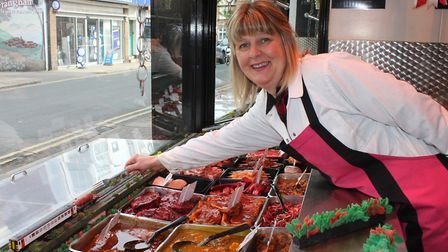 Debbie Cutting with the Sausage Express' miniature train in the window of M and D Butchers, Sheringh
