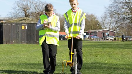 Students surveying the field at Wymondham College. Picture: ARNOLDS KEYS