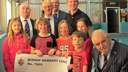 The cheque being presented to Michael Sylvester and the children by lodge members Keith London, Mark