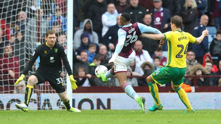 Jonathan Kodjia nips in ahead of both Michael McGovern and Ryan Bennett to puth Aston Villa out of N