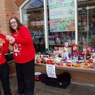 Hunstanton Sainsbury's staff Peter Mallam and Zara Stevens running the tombola on Red Nose Day. Pict