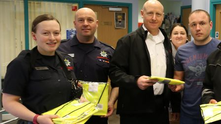 Rosmini Centre staff receiving the jackets from Wisbech firefighters. Photo from Cambridgeshire Fire