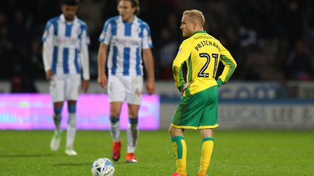 Alex Pritchard's expression says it all, as Norwich City concede the first of three goals at Hudders