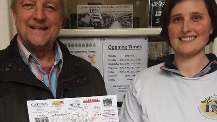 Traders Paul Oakes and Rebecca Shaw show maps created by Ms Shaw to highlight independent shops in t