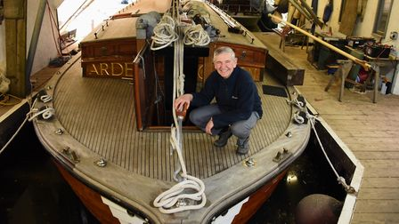 Chairman, Andrew Scull, on the pleasure wherry Ardea, which will be 90-years-old this year, moored a
