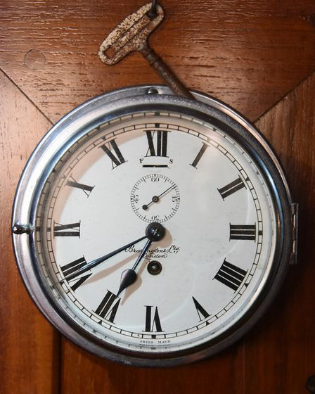 A clock with its key on the 90-year-old pleasure wherry Ardea at the Wherry Yacht Charter site at Wr