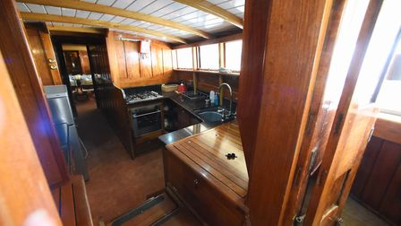 The galley on the 90-year-old pleasure wherry Ardea at the Wherry Yacht Charter site at Wroxham. Pic