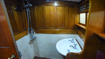 A shower and sink on the 90-year-old pleasure wherry Ardea at the Wherry Yacht Charter site at Wroxh