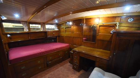 The master cabin on the 90-year-old pleasure wherry Ardea at the Wherry Yacht Charter site at Wroxha
