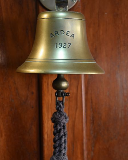 The original bell on the 90-year-old pleasure wherry Ardea at the Wherry Yacht Charter site at Wroxh