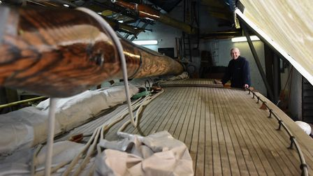 Chairman Andrew Scull, by the newly varnished mast on the 90-year-old pleasure wherry Ardea at the W